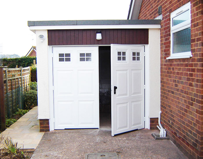 Retractable garage doors halesowen canopy garage doors for Garage side entry door